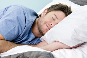 Man comfortably sleeping in his bed